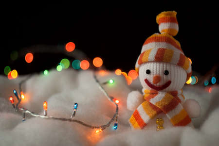 Cheerful snowman. Christmas Card whit dark background photo