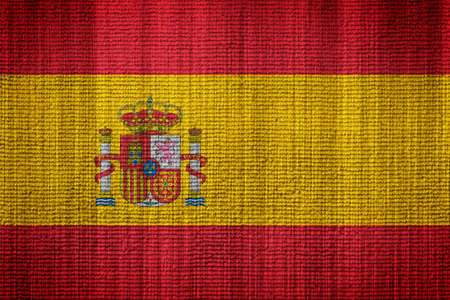 tearing down: Flag Of Spain towel texture as a background Stock Photo
