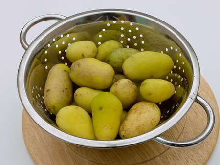 a colander: Boiled potatoes in colander. Stock Photo