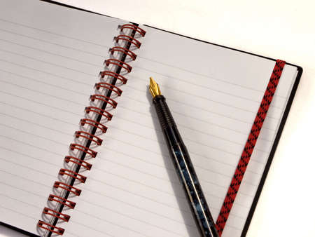 Spiral notebook open with pen Stock Photo - 3372788