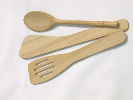 Wooden kitchen spoons used for baking. photo