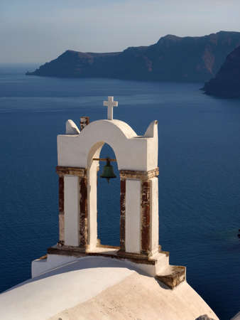 Greek church bell tower overlooking the caldera at Santorini  photo