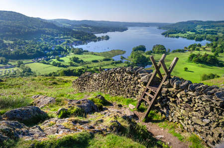 A morning shot of Lake Windermere showing the stone walling and the stile providing passage over the wall taken from just above Ambleside.