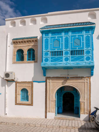 Typical Tunisian house frontage showing door, balcony and windows well known for the use of blue and white decoration.