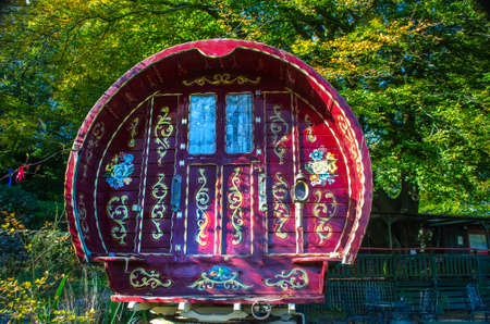 The end on shot of a Gypsy Caravan, Grasmere, Cumbria England 6 October 2018 showing the intricate decoration in paint.