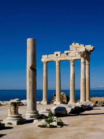 The remains of the temple of Apollo at Side on the southern coast of Turkey. Showing the remains with the deep blue sky of the Mediterranean.