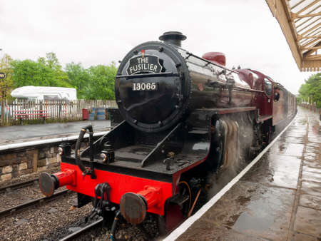 East Lancs. Railway at Ramsbotton Railway Station Bury 25th May 2014 showing the steam train The Fusilier standing at the platform.