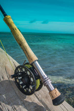Saltwater fly fishing fly rod and reel an the beach in Caribbean sea - los roques