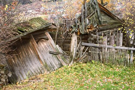 The old wooden destroyed house. photo