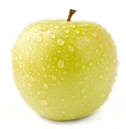 Green apple on the white background. Stock Photo