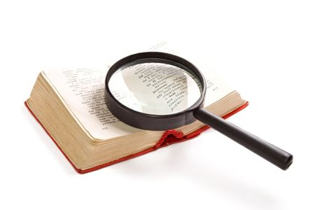 Magnifying glass and book isolated on the white background photo