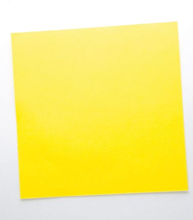 Yellow sticky note isolated on the white background photo
