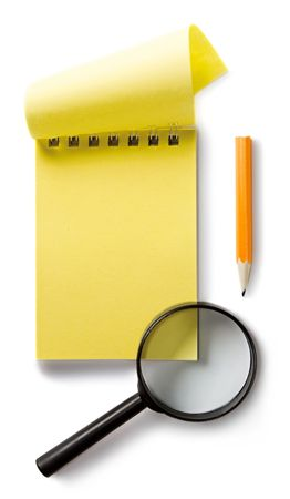 Notepad and magnifying glass isolated on white photo