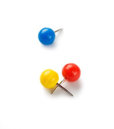 yellow tacks: Push pins isolated on white