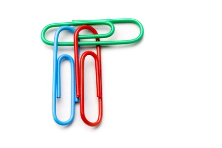 Paper clip isolated on white photo