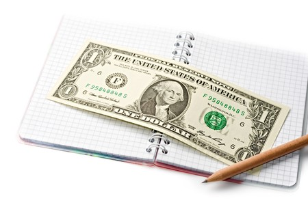 Notepad, pencil, dollar isolated on white photo