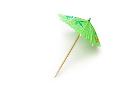 toothpick: Cocktail umbrella isolated on white