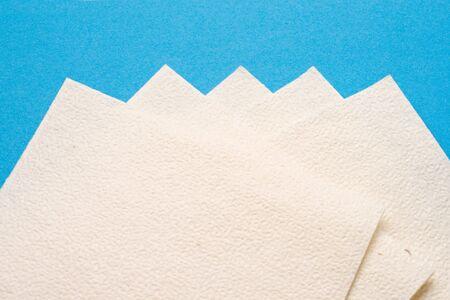Napkins isolated on blue background photo