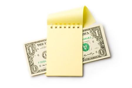 Notepad, dollar isolated on white  photo