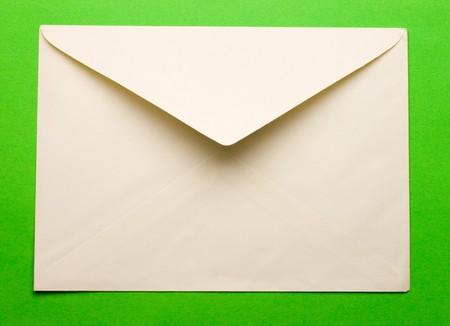 envelope: Evenlope isolated on green