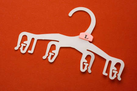 Hanger isolated on red Stock Photo - 8052640
