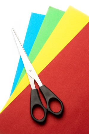 Colored paper and scissors isolated on white photo
