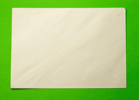 Envelope isolated on green photo