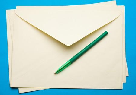 Envelope isolated on blue photo