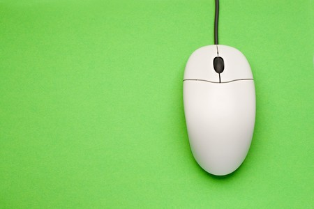 Computer mouse isolated on the green background  photo