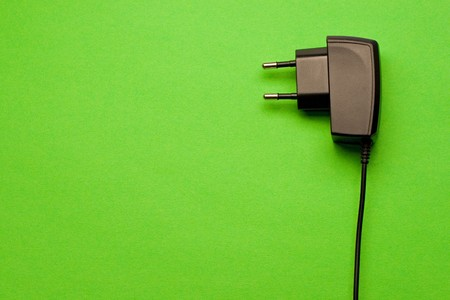 Electric plug isolated on the green background  photo