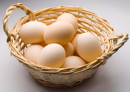 small basket: Brown eggs in the basket Stock Photo