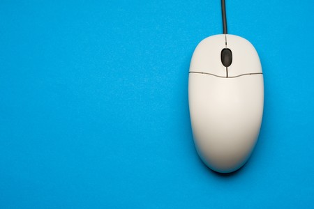 Computer mouse isolated on the blue background