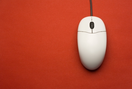 Computer mouse isolated on the red background