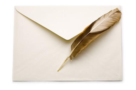 Envelope and feather isolated on white Stock Photo - 8213263