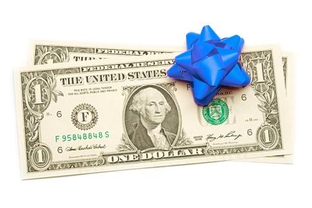 christmas profits: Dollar with holidays bow isolated on white Stock Photo