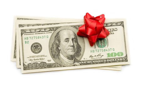 christmas savings: Dollar with holidays bow isolated on white Stock Photo
