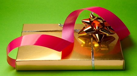 Gift box isolated on green photo