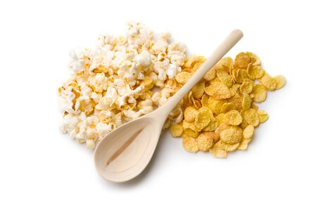 Popcorn, cornflakes and spoon isolated on white photo