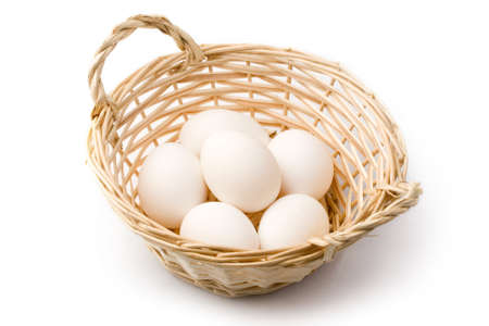 Eggs in basket isolated on white photo