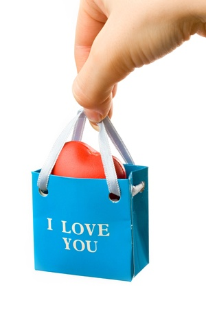 romantic: Hand with bag isolated on white background