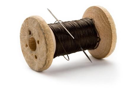 cotton thread: Thread bobbin and needle on white background  Stock Photo