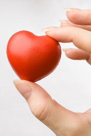 Female hand with red heart photo