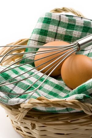 Fresh eggs in a woven basket photo