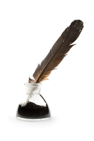 Feather and ink bottle isolated on white photo