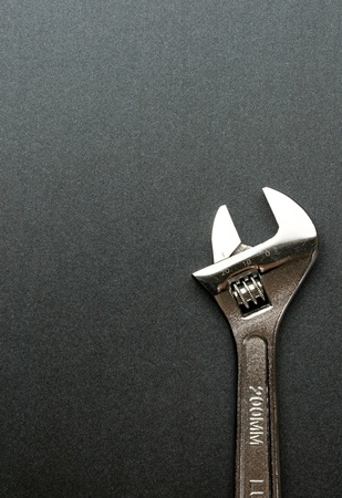 Spanner isolated on grey photo