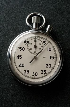 Stopwatch isolated on dark photo
