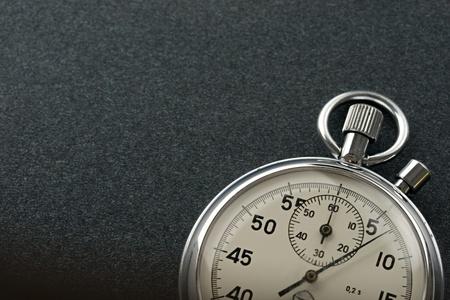 metering: Stopwatch isolated on dark Stock Photo