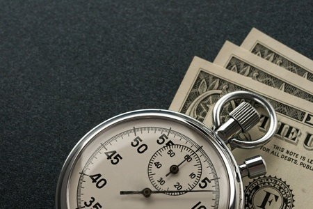 instrument of time: Stopwatch and dollar