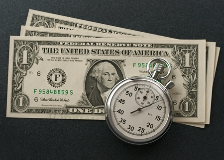 Stopwatch and dollars photo