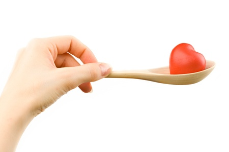 Hand with spoon photo